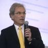 Dr. med. Christian Flügel-Bleienheuft vom Gesundheitsnetz Köln-Süd stellt das TK-PraxisNetzwerk vor.