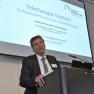 """Dr. Alexander Wolff von Gudenberg stellt das spätere Gewinner-Projekt vor: """"Teletherapie Stottern – Onlinebasierte Intensiv-Stottertherapie""""."""