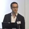 """Expertenvortrag Nummer zwei: Herr Dr. rer. Nat. Patrick Pfeffer von der aescuvest GmbH referiert zur """"Finanzierung medizinischer Innovationen über die Crowd?"""""""